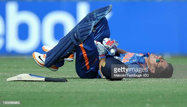 Prashant Chopra of India lies on the ground in pain after being hit in the groin by a ball from Ed Nuttall of New Zealand during the ICC U19 Cricket...