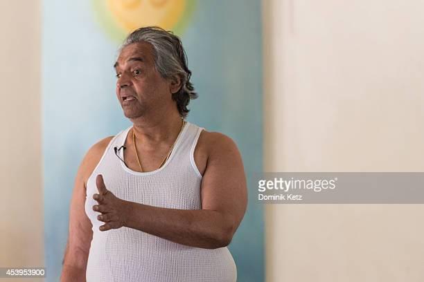 Prashant Iyengar seen teaching a yoga class at the B.K.S. Iyengar Memorial Yoga Institute in March of 2012 in Pune, India.