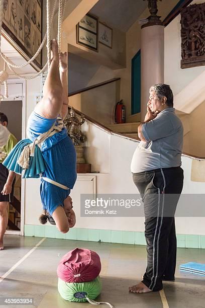 Prashant Iyengar seen teaching a yoga class at the BKS Iyengar Memorial Yoga Institute in March of 2012 in Pune India