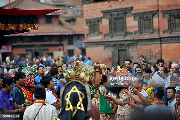 Prashant Mali 23yrs impersonate as deity Vaishnavi carry sheep for the ritual sacrificial procession during 12 year Shree Bagh Bhairab Dance Jatra...