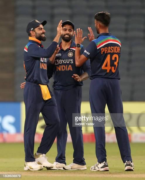 Prasidh Krishna of India celebrates with Virat Kohli after dismissing Sam Billings of England during 1st One Day International between India and...