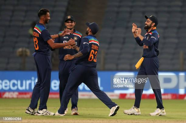 Prasidh Krishna of India celebrates witrh teammates after dismissing Tom Curran of England during 1st One Day International between India and England...