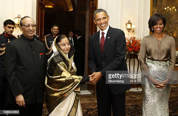 Pratibha Patil India's president second from left shakes hands with US President Barack Obama as US First Lady Michelle Obama looks on at the...