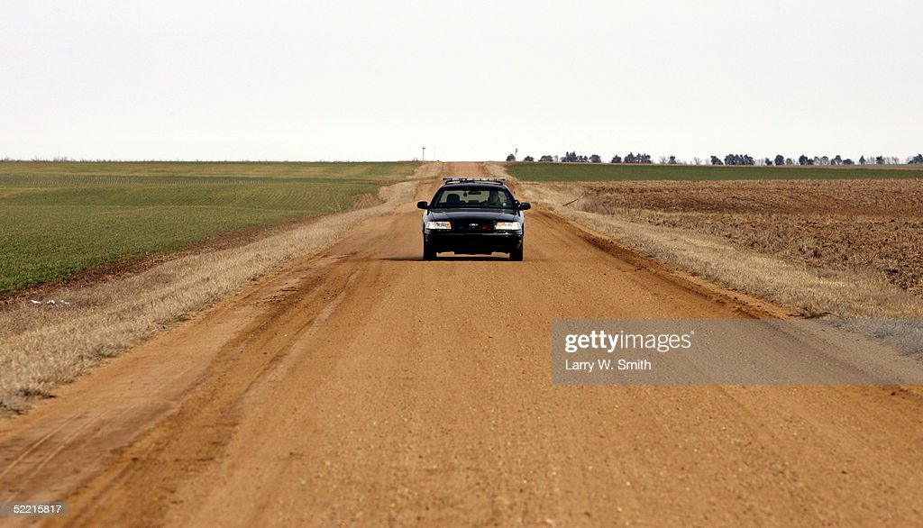 A Pratt County Sheriff car patrols the rural areas on February 18, 2005 near Pratt, Kansas. The Pratt County sheriff office has over 700 square acres of rural land to patrol on a daily basis looking for any kind of methamphetamine substances such as trash or labs.