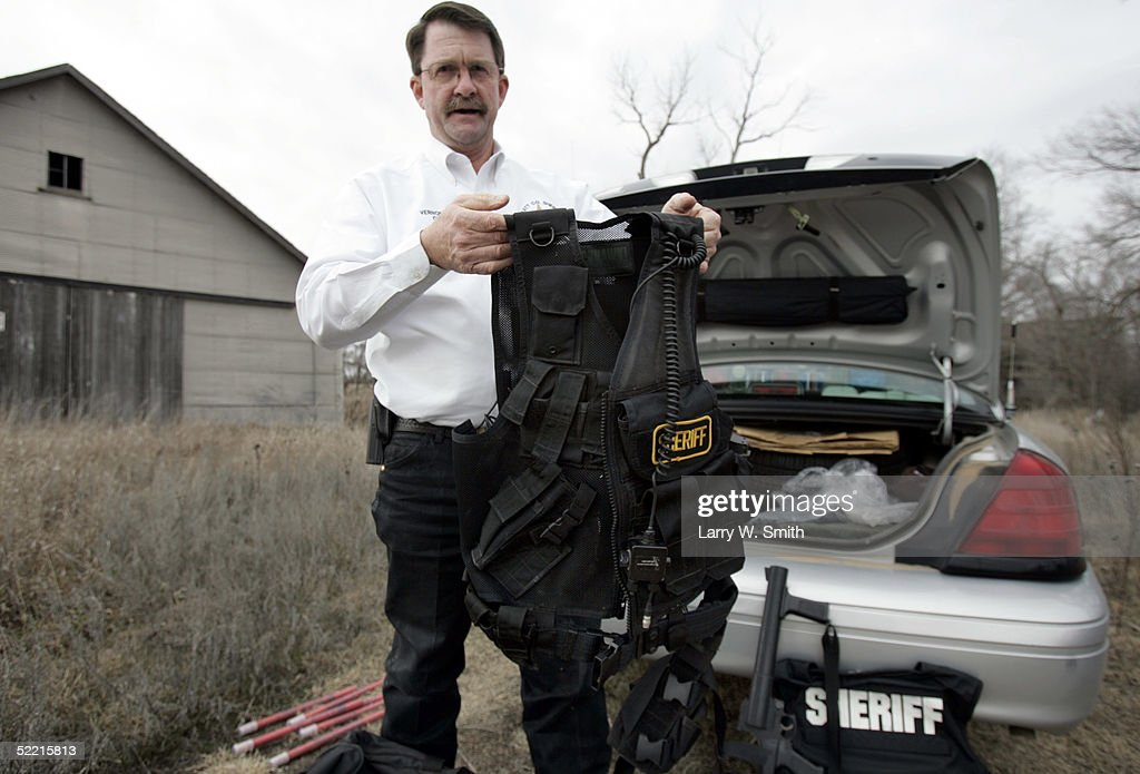 Pratt County Sheriff Vernon Chinn holds up some of the department's new gear for fighting the meth crime on February 18, 2005 after looking for leftover items used in the making of methamphetamine while he patrols the rural areas near Pratt, Kansas. The Pratt County sheriff office has over 700 square acres of rural land to patrol on a daily basis looking for any kind of methamphetamine substances such as trash or labs.