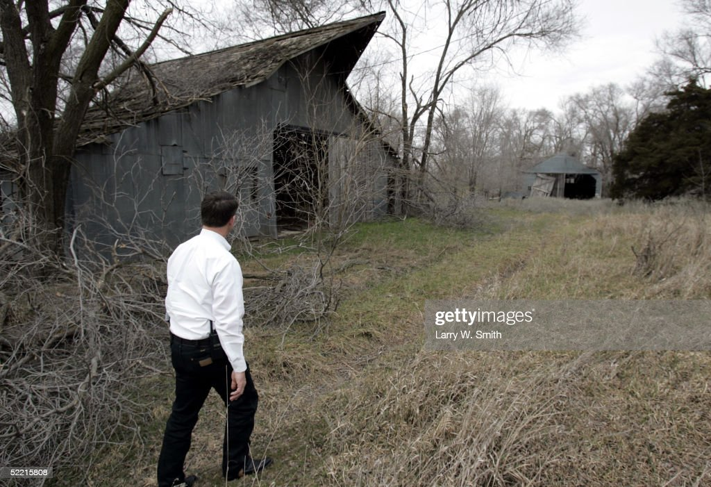 Pratt County Sheriff Vernon Chinn walks through a pasture to look in some abandoned barns on February 18, 2005 for left over items used in the making of methamphetamine while he patrols the rural areas near Pratt, Kansas. The Pratt County sheriff office has over 700 square acres of rural land to patrol on a daily basis looking for any kind of methamphetamine substances such as trash or labs.