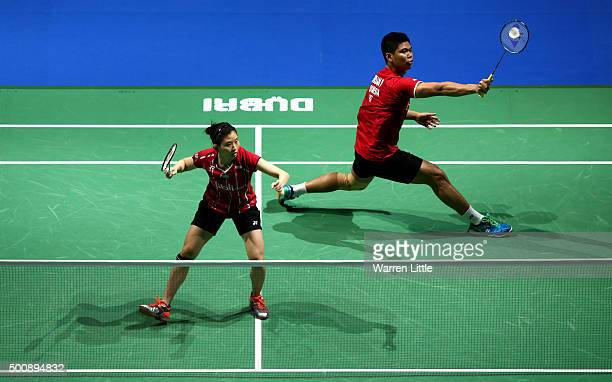 Praveen Jordan and Debby Susanto of Indonesia in action against Joachim Fischer Nielsen and Christinna Pedersen of Denmark during day three of the...