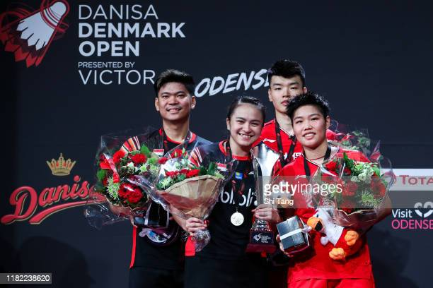 Praveen Jordan and Melati Daeva Oktavianti of Indonesia and Wang Yilyu and Huang Dongping of China pose with their trophies after the Mixed Double...