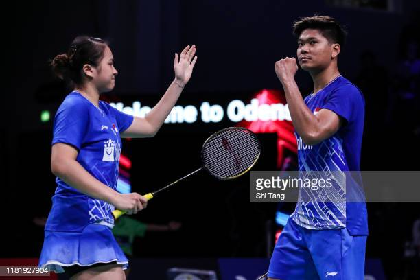 Praveen Jordan and Melati Daeva Oktavianti of Indonesia celebrate the victory in the Mixed Doubles quarter finals match against Zheng Siwei and Huang...