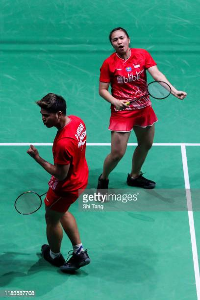 Praveen Jordan and Melati Daeva Oktavianti of Indonesia celebrate the victory in the Mixed Doubles semi finals match against Chris Adcock and...