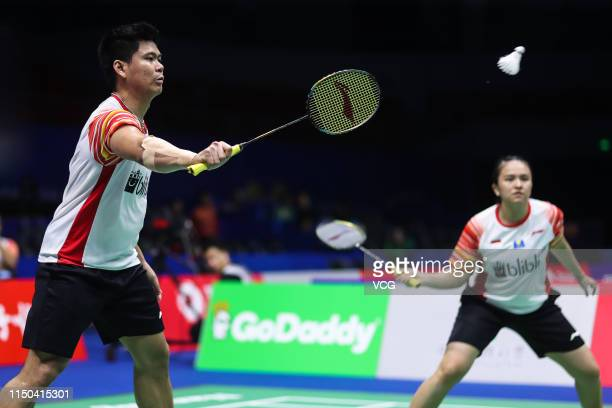 Praveen Jordan and Melati Daeva Oktavianti of Indonesia compete in the Mixed Doubles match against Chris Adcock and Gabrielle Adcock of England...
