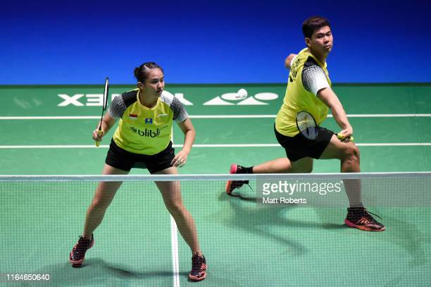 Praveen Jordan and Melati Daeva Oktavianti of Indonesia compete in the Mixed Doubles Final match against Wang Yi Lyu and Huang Dong Ping of China on...
