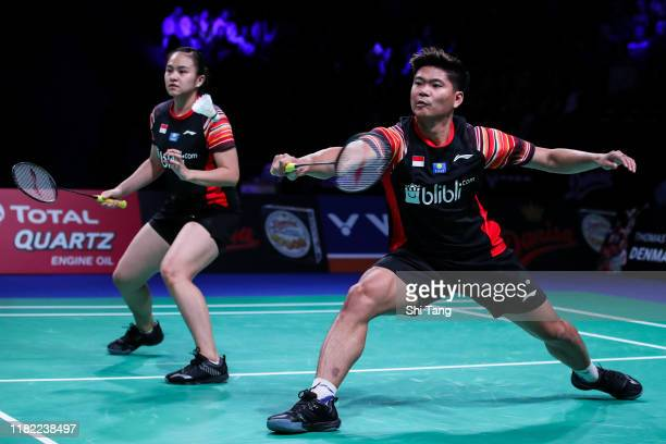 Praveen Jordan and Melati Daeva Oktavianti of Indonesia compete in the Mixed Double final match against Wang Yilyu and Huang Dongping of China on day...