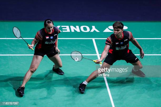 Praveen Jordan and Melati Daeva Oktavianti of Indonesia compete in the Mixed Double final match against Zheng Siwei and Huang Yaqiong of China on day...