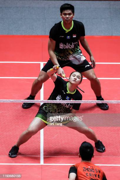 Praveen Jordan and Melati Daeva Oktavianti of Indonesia compete in the Mixed Doubles round robin match against Zheng Siwei and Huang Yaqiong of China...