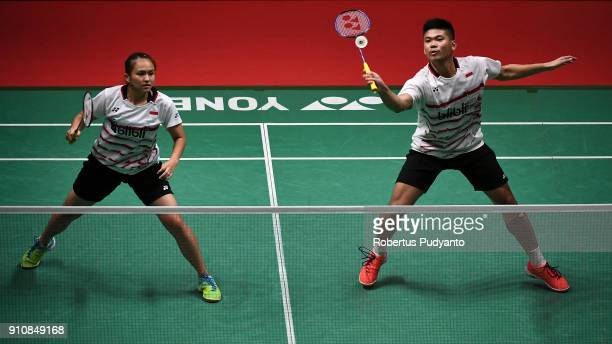 Praveen Jordan and Melati Daeva Oktavianti of Indonesia compete against Tontowi Ahmad and Liliyana Natsir of Indonesia during the Mixed Doubles Semi...