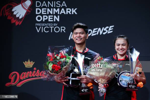 Praveen Jordan and Melati Daeva Oktavianti of Indonesia pose with their trophies after the Mixed Double final match against Wang Yilyu and Huang...