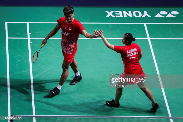 Praveen Jordan and Melati Daeva Oktavianti of Indonesia react in the Mixed Doubles semi finals match against Chris Adcock and Gabrielle Adcock of...