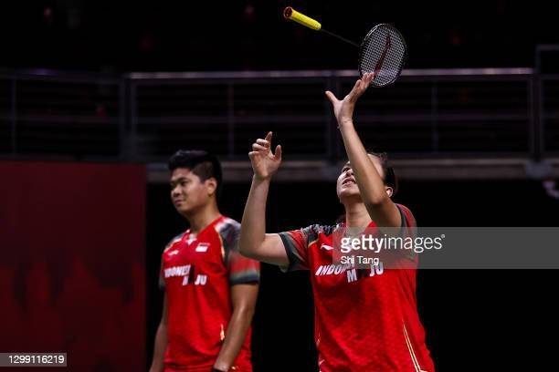 Praveen Jordan and Melati Daeva Oktavianti of Indonesia react in the Mixed Doubles round robin match against Marcus Ellis and Lauren Smith of England...