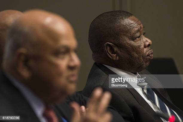 Pravin Gordhan South Africa's finance minister left and Blade Nzimande South Africa's higher education minister look on during a news conference...