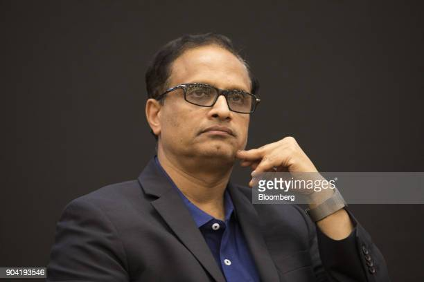 Pravin Rao chief operating officer of Infosys Ltd pauses during a third quarter earnings news conference in Bengaluru India on Friday Jan 12 2018...