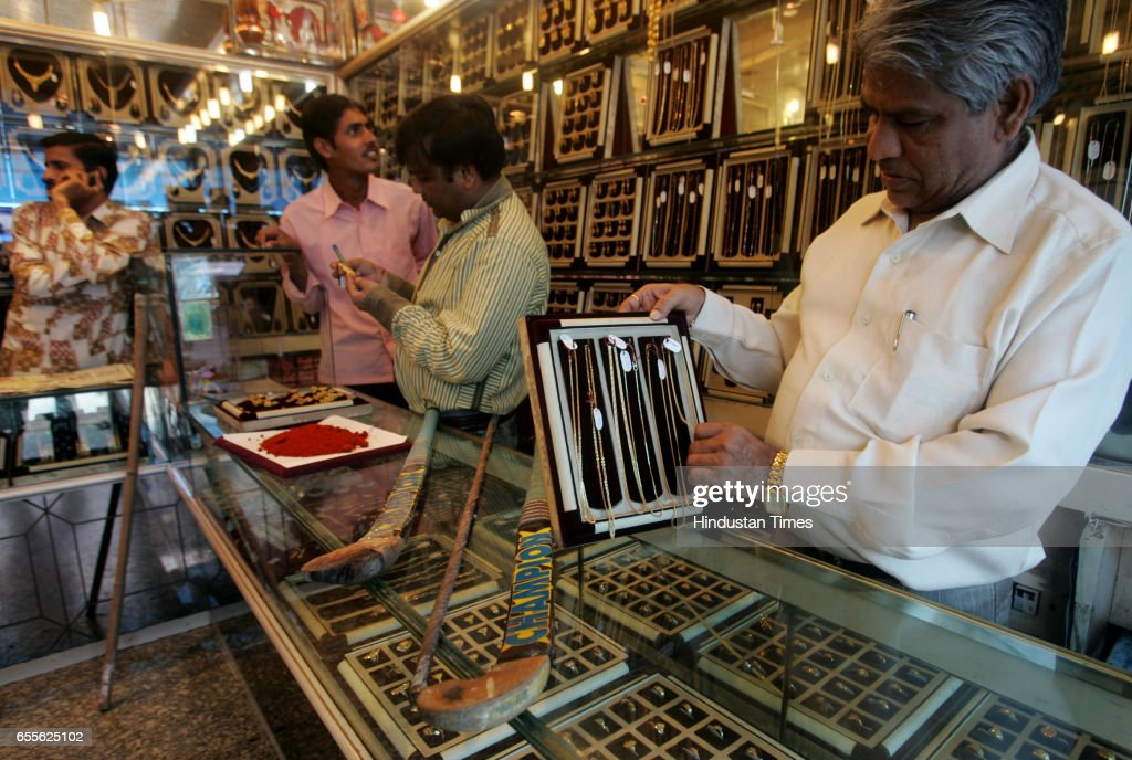 Pravinchand Jain checks the jewllery stock at his Kardhar jewllery shop at ailway station road in Goregaon west who is one of the 40 jewellers in the locality who have started keeping iron rods, hockey sticks and chilli powder for self defense.