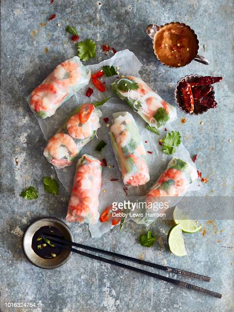 Prawn rolls on rice paper and pair of chopsticks