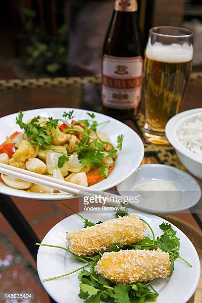 Prawn-filled rolls and scallop dish, with Bia Hanoi beer, at restaurant on P Dien Bien Phu street.