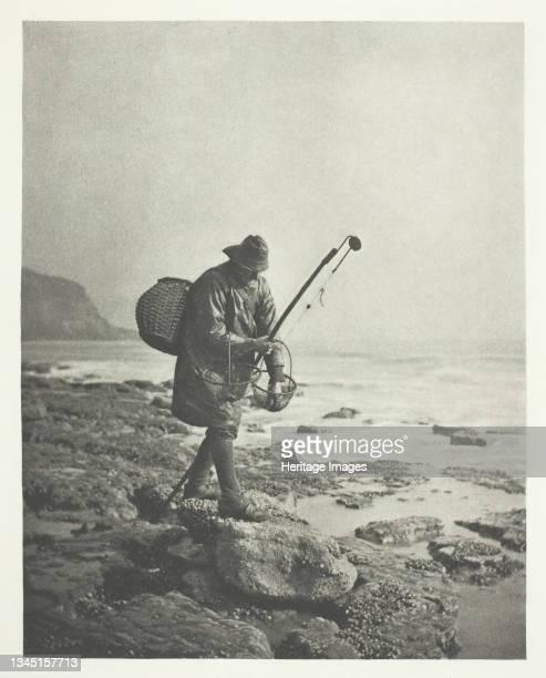 "Prawning printed January 1891. [Fisherman on rocky beach]. Photogravure, from ""Sun Artists, number 6"" . Artist B. Gay Wilkinson."