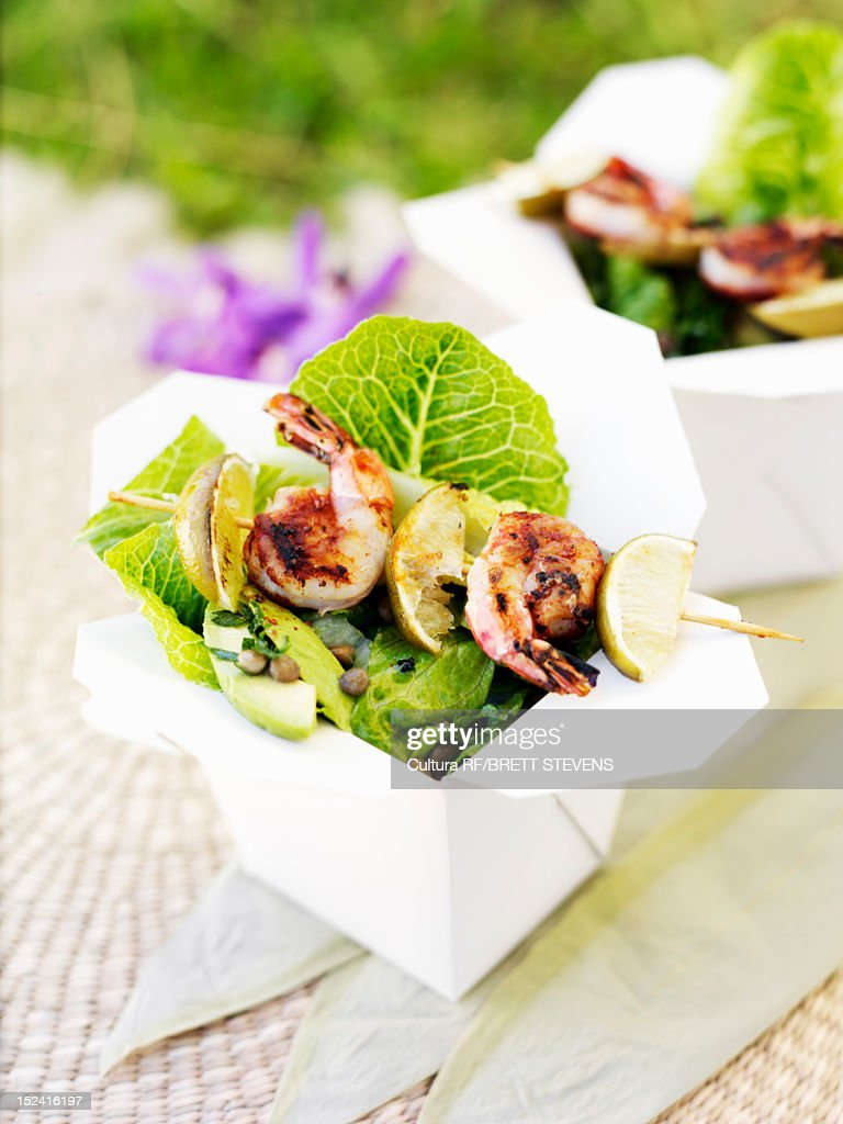 Prawns with salad in takeout boxes : Stock Photo