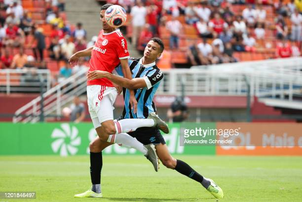 Praxedes of Internacional and Gazao of Gremio fisght for the ball controls the ball during the match between Internacional and Gremio for the Copa...