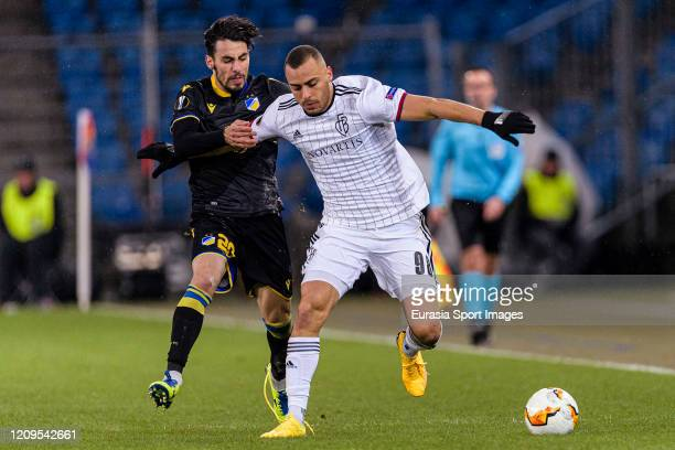 Praxitelis Vouros of Apoel in action against Arthur Cabral of Basel during the UEFA Europa League round of 32 second leg match between FC Basel and...