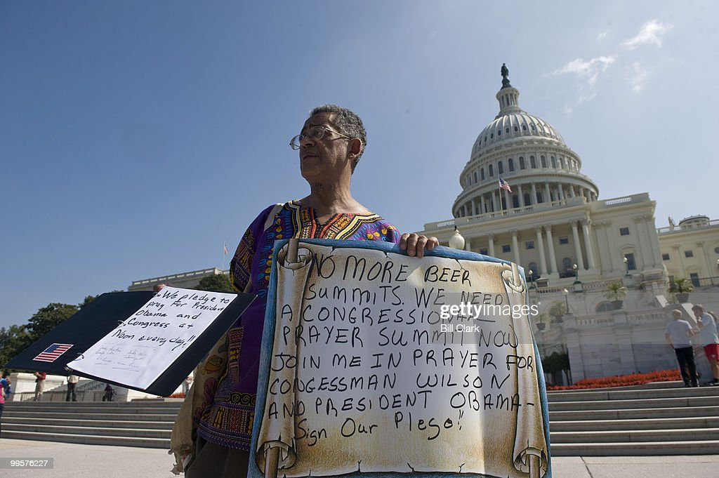 Pray at the Pump founder Rocky Twyman, of Rockville, Md., asks tourists on the West Front of the Capitol to pledge to pray for President Obama and Rep. Joe Wilson, R-S.C., on Tuesday, Sept. 15, 2009, following Wilson's outburst during Obama's speech last week.