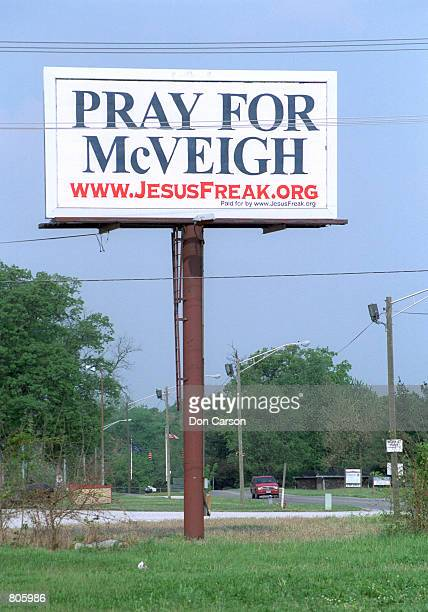 A Pray for McVeigh billboard stands on a road near the Honey Creek Shopping Center close to the US Penitentiary May 1 2001 in Terre Haute Indiana The...