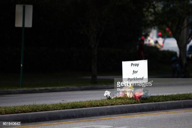 A 'Pray for Parkland' sign is displayed on a median during the ENOUGH National School Walkout rally at Marjory Stoneman Douglas High School in...
