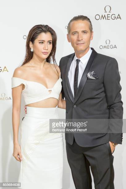 Praya Lundberg and Raynald Aeschlimann attend 'Her Time' Omega Photocall as part of the Paris Fashion Week Womenswear Spring/Summer 2018 on September...