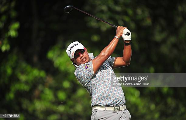 Prayad Marksaeng of Thailand plays a shot during round one of the CIMB Classic at Kuala Lumpur Golf Country Club on October 29 2015 in Kuala Lumpur...