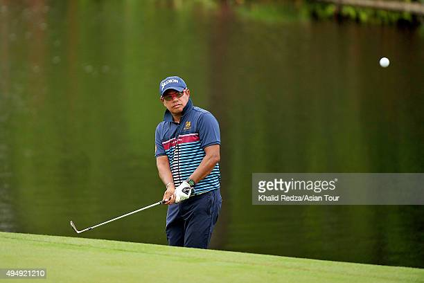 Prayad Marksaeng of Thailand plays a shot during round two of the CIMB Classic at Kuala Lumpur Golf & Country Club on October 30, 2015 in Kuala...