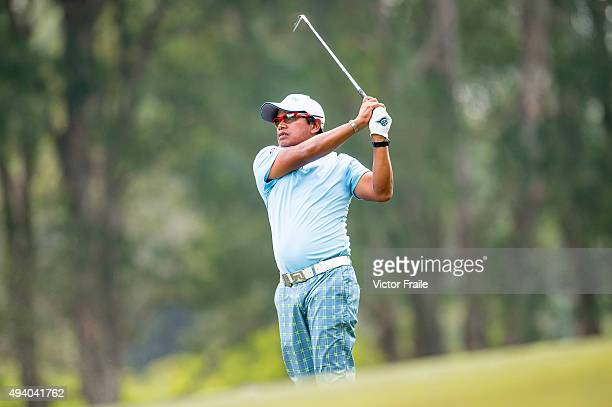 Prayad Marksaeng of Thailand plays a shot on the 18th hole during the third round of the UBS Hong Kong Open at the Hong Kong Golf Club on October 24...