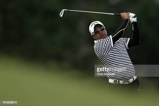 Prayad Marksaeng of Thailand plays his seond shot on the eighth hole during day one of the Panasonic Japan Open at Ibaraki Golf Club on September 26...