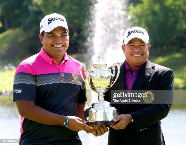 Prayad Marksaeng of Thailand poses for photographs with his son after the final round of the 27th Japan Senior Open Golf Championship at The Classic...