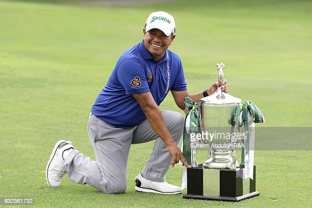 Prayed Marksaeng of Thailand poses for a photo after winning the SMBC Singapore Open at Sentosa Golf Club on January 22 2017 in Singapore