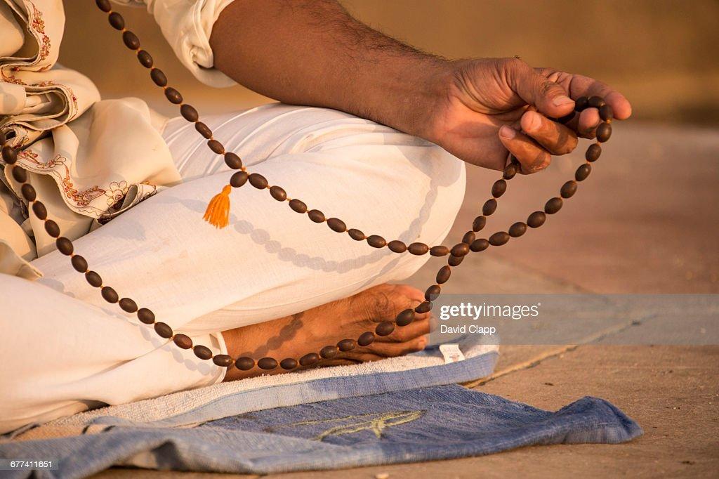 Prayer beads, a man meditating, Varanasi, India : Stock Photo
