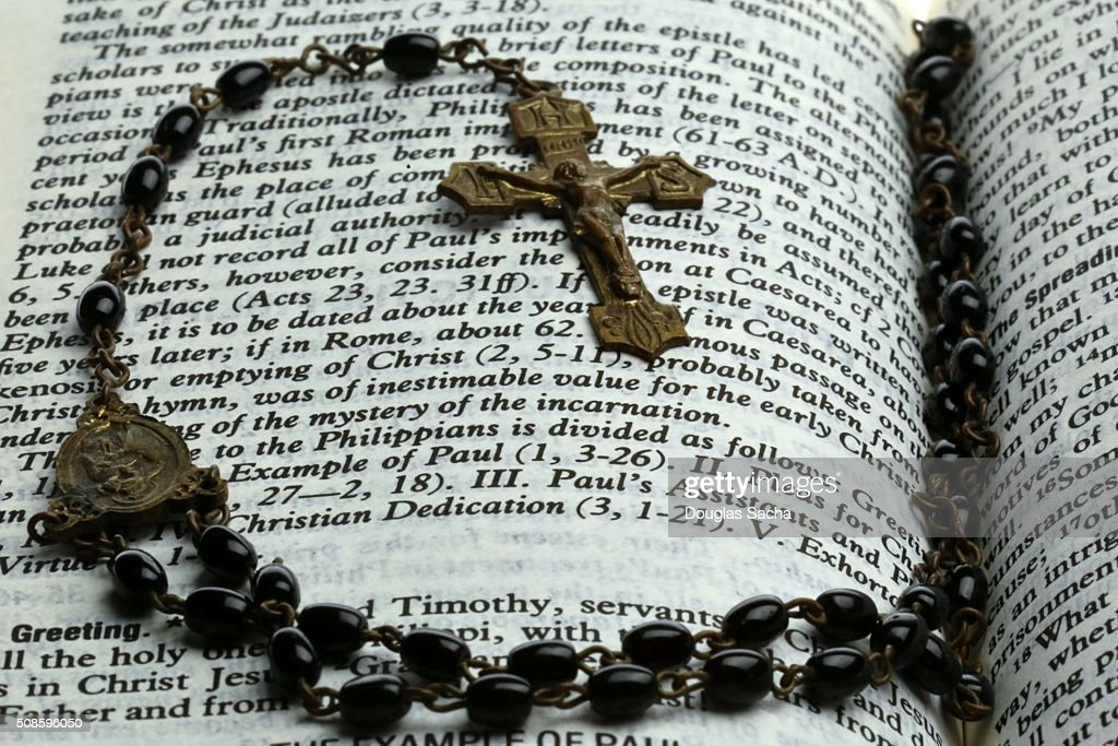 Prayer beads on a holy bible : Stock Photo