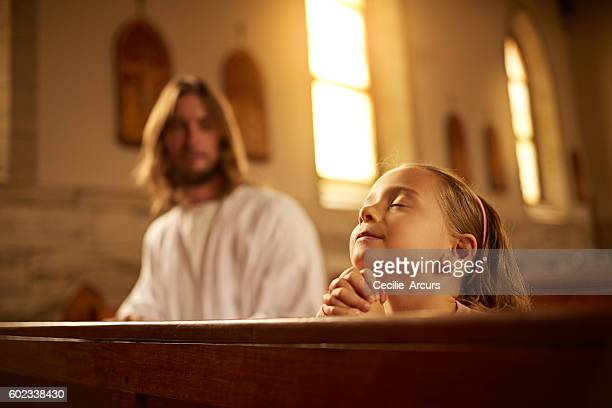 prayer brings her closer to jesus - jesus christ photos stock pictures, royalty-free photos & images