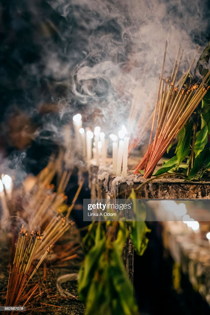 Prayer Candles And Incense Smoking On A Prayer Altar Stock-Foto