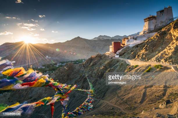 prayer flag in tsemo castle with beautiful mountain snow landscape background in leh ladakh - kashmir valley stock pictures, royalty-free photos & images
