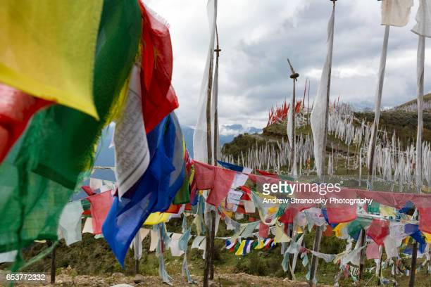 prayer flags at chele la pass - paro district stock pictures, royalty-free photos & images