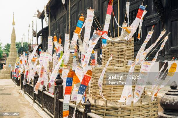 prayer flags at the entrance of a buddhist temple in chiang mai, thailand - buddhist new year stock pictures, royalty-free photos & images