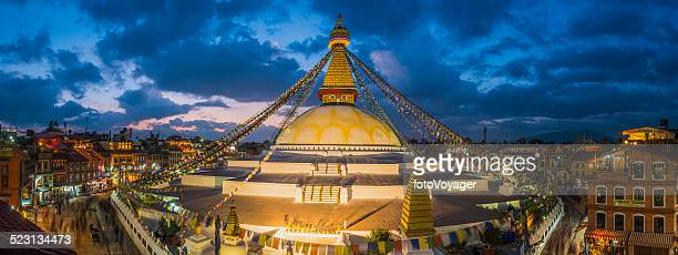 Prayer flags Buddhist stupa illuminated panorama at Boudhanath Kathmandu Nepal